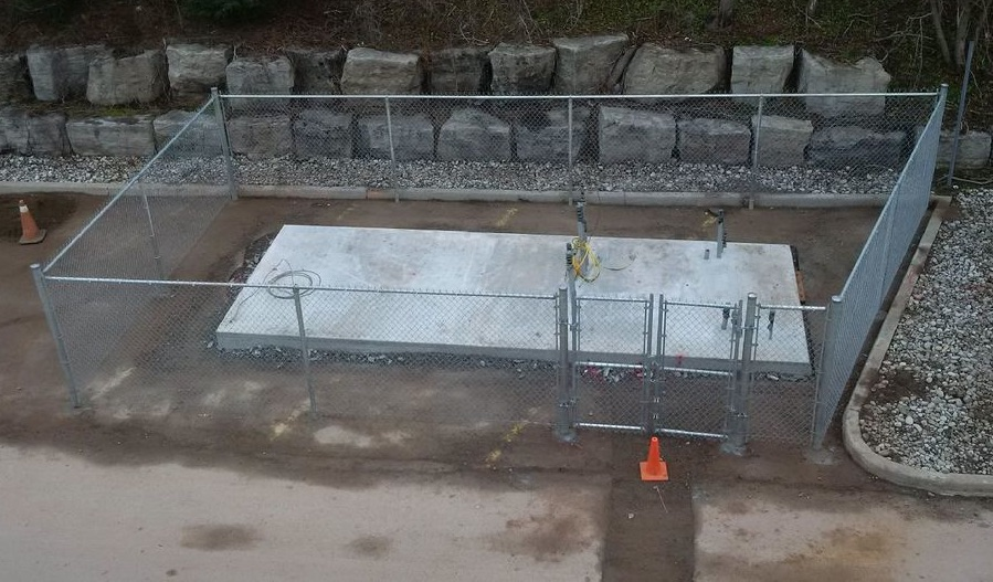 Fenced Concrete Pad for battery and gas generator at Burlington DC Microgrid project